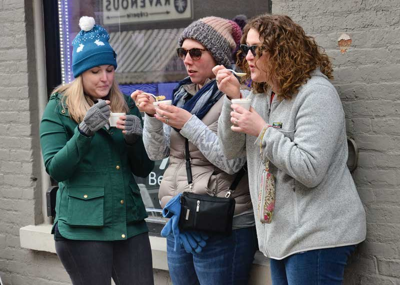 Sampling cups of chowder at Saratoga Chowderfest 2020 on Feb. 1:  Andrea Connor, Liz Otto, and Jennalee Lukaes. Photo by SuperSource Media.