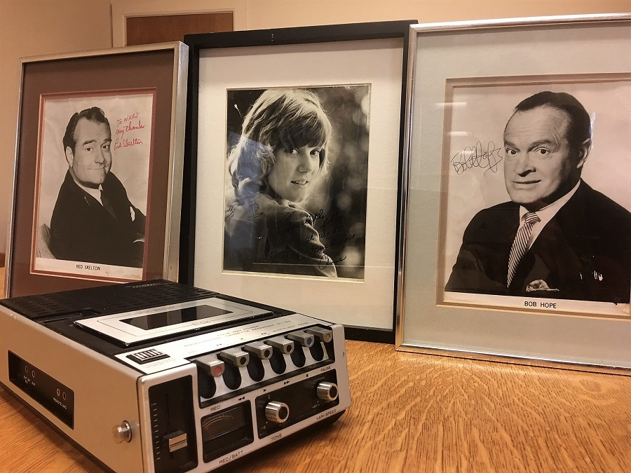 Memorabilia from the Saratoga Fair, and an old-school tape recorder, such as was used in the 1970s for recording interviews.