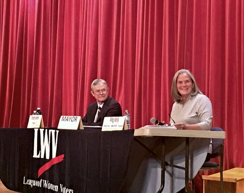 Republican mayoral candidate Tim Holmes and incumbent Democrat mayor Meg Kelly on the second of two Meet The Candidates nights, Oct. 22, 2019, sponsored by the League of Women Voters of Saratoga County, and staged at the Saratoga Springs High School auditorium. Photo by Thomas Dimopoulos.