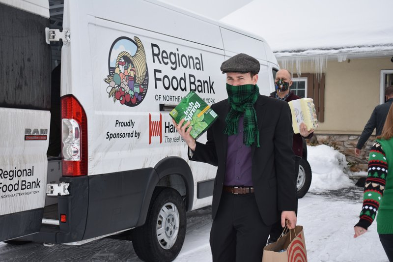 More than 3,000 pounds of food were collected during the Sterling Homes Real Estate Holiday Heroes Project Food Drive and donated to the Regional Food Bank of NENY. Photo provided.