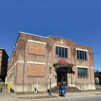 SOLD! Woodlawn Ave. Building Brings $2.8 Million Bid