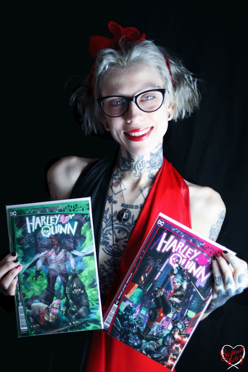 Image of Janna aka Sweetheart.Harley, holding copies donated and autographed by author Stephanie Phillips, that are being raffled to benefit the National Coalition Against Domestic Violence.